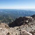 View northeast from the summit of Pikes Peak (14,115 ft).- Pikes Peak Summit + Highway