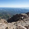 View northeast from the summit of Pikes Peak (14,115 ft).- Pikes Peak Summit + Highway