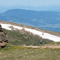 Hiker descending the Devils Playground Trail.- Pikes Peak, Crags Route Hike