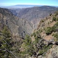 Views east of the Gunnison River's descent down the Black Canyon of the Gunnison, from Warner Point Nature Trail.- Warner Point Nature Trail