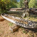A ceremonial canoe carved from a redwood tree.- Sumêg Village