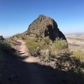 The saddle sits at about a mile into the hike.- Picacho Peak via Hunter Trail