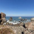 A uniquely shaped rock sits in the open ocean.- Wedding Rock Coastal Access