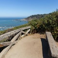 Palmer's Point has a single bench to relax and soak up the view.- Palmer's Point + Coastal Access