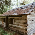 A dilapidated cabin formerly designated the Ladies Cabin.- Ah-Di-Na Campground