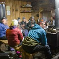 Festivities around the wood stove.- Hemlock Butte Cabin