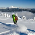 Enjoying the fresh turns and views of Mount Theilsen along the southeast ridge.- Mount Bailey Backcountry Skiing