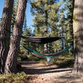 Trees line the shore, making for a perfect afternoon hammock siesta.- Long Lake Swimming Hole via Palisades Creek Trail