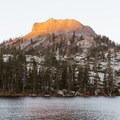 Devils Peak and Long Lake in the morning light.- Long Lake Swimming Hole via Palisades Creek Trail