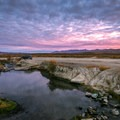 Dramatic sunrises over one of the hot pools in Bog Creek.- Bog Hot Springs