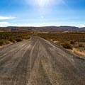 The well-graded dirt road leading to Virgin Valley Campground and warm springs.- Virgin Valley Campground
