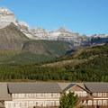 Mount Wilbur (9,326 ft) beyond Many Glacier Hotel.- Many Glacier Hotel + Swiftcurrent Lake