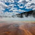 Grand Prismatic Spring steaming.- Grand Prismatic Spring + Midway Geyser Basin