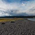 Dark stone and sand beach.- Gull Point on Yellowstone Lake