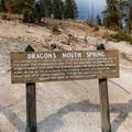 Dragons Mouth Spring informational sign.- Mud Volcano Area