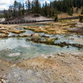Sulfur pools near the parking area.- Mud Volcano Area