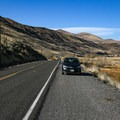 Parking is a narrow strip of gravel along the shoulder of the road.- Eagleville Hot Springs