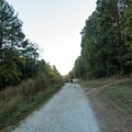 The trail starts on the Cochran Shoals gravel running loop.- Sope Creek