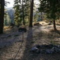 Campsites each contain a table and a grill.- Stough Reservoir