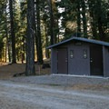 Vault toilets are the only amenities at the campground.- Stough Reservoir