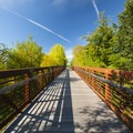 Pedestrian bridge on the north end of the Fanno Creek Trail just east of Highway 217.- Greenway Park + Fanno Creek Trail