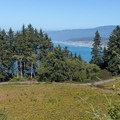 Big Lagoon County Beach in the distance between the trees.- Ceremonial Rock