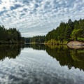 Reflection of the clouds in Thetis Lake. - Thetis Lake