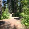 One of several vault toilet facilities.- Delta Campground