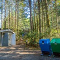 Toilets, garbage and recycling.- Spring Salmon Place Campground
