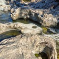 Interesting rock formations on the Sooke River.- Spring Salmon Place Campground