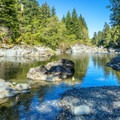 Hideaway Beach is accessible from the campground.- Spring Salmon Place Campground