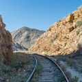 The trail meanders next to the abandoned tracks.- Goat Canyon Trestle Trail