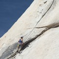A climber makes her way up Toe Jam (5.7) on the southeast face of Old Woman Rock.- Old Woman Rock - Climbing Crag