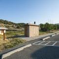 Vault toilet facility at Crandall Campground.- Crandall Campground + Group Campground