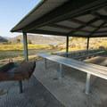Picnic shelter and grill at Crandall Group Campground.- Crandall Campground + Group Campground
