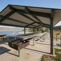Picnic shelter and grills at Lariat Loop Group Campground.- Lariat Loop Group Campground