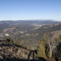 The foothills of the Gallatin Range and the Crazy Mountains in the far distance.- Lower Mount Ellis