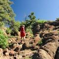 Climbing up the rocky summit.- Mount Herman