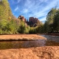 View of Cathedral Rock while wading in Oak Creek.- Crescent Moon Ranch