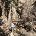 Checking out Hidden Falls near the Mill B North Fork Trail.- Mill B North Fork Trail