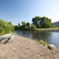 Picnic area along the Weber River at Riverside/Old Church Campground.- Riverside/Old Church Campground