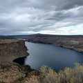 On a cloudy day, the Crooked River appears inky black.- Tam-a-Láu Trail