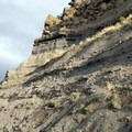 Crumbly bands of rock decorate the canyon.- Tam-a-Láu Trail