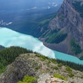 Lake Louise dotted with kayakers.- Devil's Thumb
