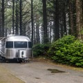 Some sites have a distant view of the ocean.- Cape Blanco State Park Campground