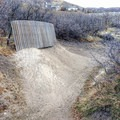 A wall ride on the single track skills trails.- Draper Cycle Park