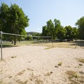 Sand volleyball court at Anderson Cove Campground.- Anderson Cove Campground + Swim Beach