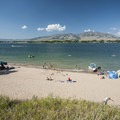 View of the beach at Anderson Cove Campground on Pineview Reservoir's southern shore.- Anderson Cove Campground + Swim Beach