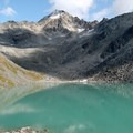 Upper Reed Lake with Talkeetna Mountain peaks (6,536 ft) above.- Reed Lakes Trail