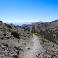 Gentle trail is replaced by steep switchbacks up the mountain.- Mount Rose Summit Trail